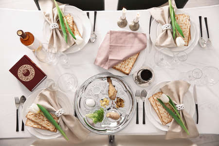 Festive Passover table setting with Torah, top view. Pesach celebration