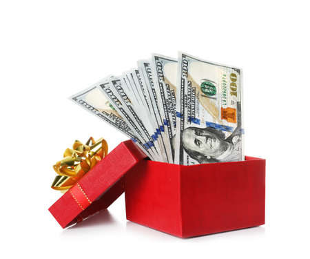 Gift box with dollar banknotes on white background