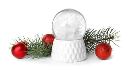 Magical snow globe with pine branches and Christmas balls on white background