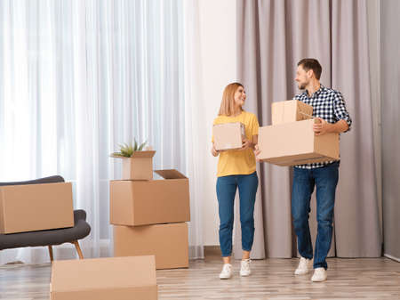 Couple with moving boxes in their new house