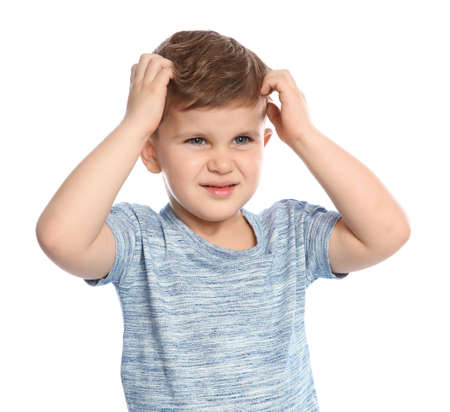 Little boy scratching head on white background. Annoying itch Stock Photo