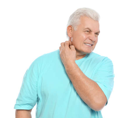 Mature man scratching neck on white background. Annoying itch Standard-Bild