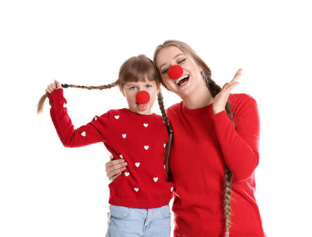 Happy woman and daughter with clown red noses on white background Banco de Imagens