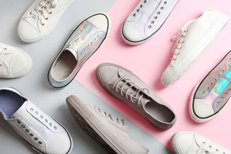 Flat lay composition with different sneakers on color background Imagens