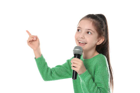 Little girl singing into microphone on white background 版權商用圖片