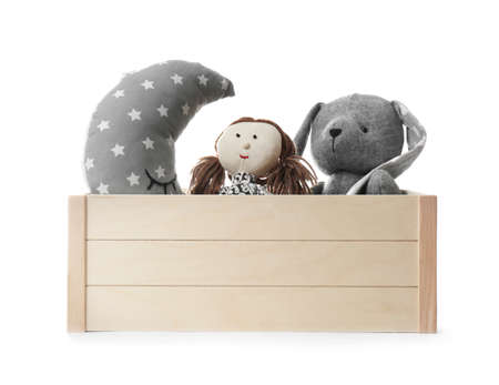 Box with stuffed toys on white background
