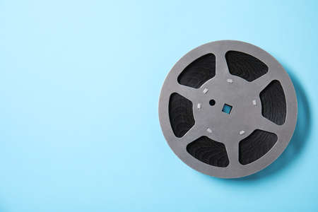Movie reel on color background, top view with space for text. Cinema production