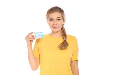 Happy young woman with driving license on white background Banque d'images