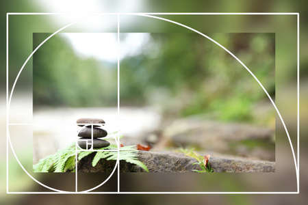 Fibonacci spiral and zen stones outdoors. Golden ratio concept