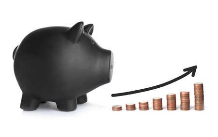 Black ceramic piggy bank and coins on white background Standard-Bild - 117325917