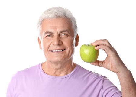 Mature man with healthy teeth and apple on white background 스톡 콘텐츠
