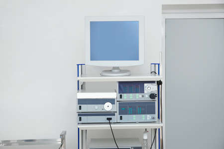 Modern endoscope in diagnostic room. Space for text