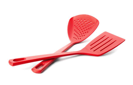 Slotted spatula and skimmer on white background