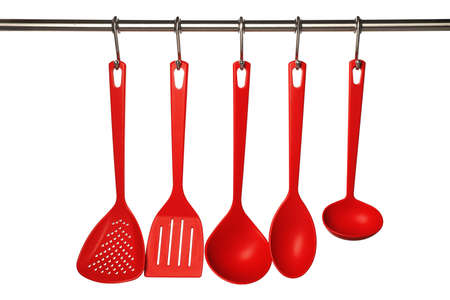 Set of kitchen utensils hanging against white background Stock fotó
