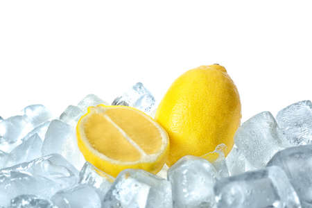 Fresh lemons on ice cubes against white background
