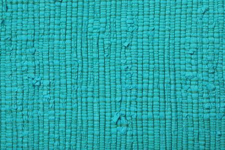 Color woven carpet texture as background, top view 免版税图像