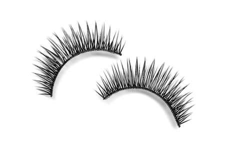 Beautiful pair of false eyelashes on white background, top view Banco de Imagens