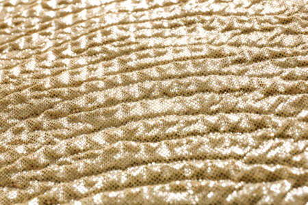 Golden fabric with shiny paillettes as background