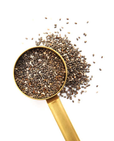 Saucepan and chia seeds isolated on white background, top view Stock Photo
