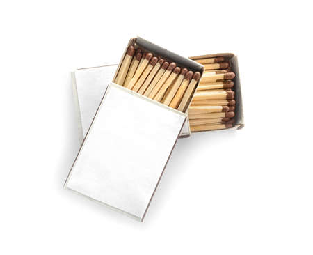Cardboard boxes with matches on white background, top view. Space for design