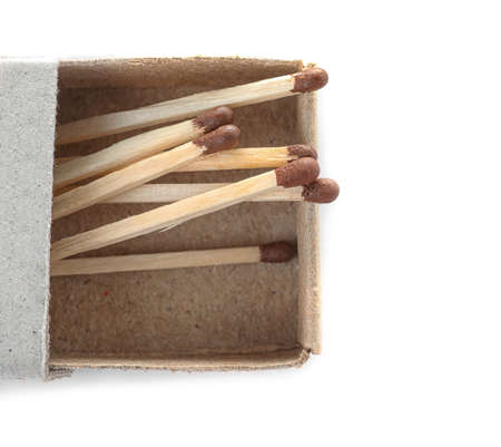 Cardboard box with matches on white background, top view