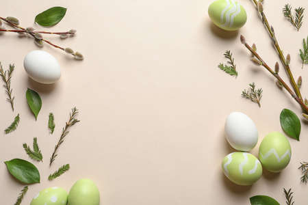 Flat lay composition with painted Easter eggs on color background, space for text