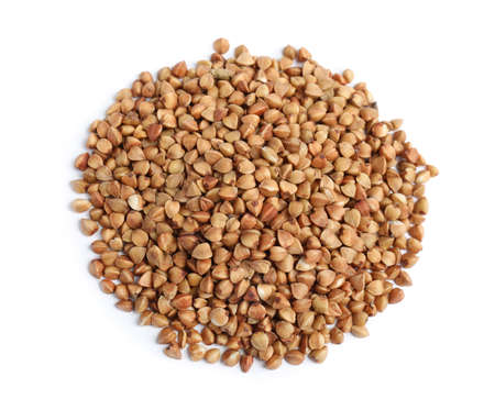 Uncooked buckwheat on white background, top view
