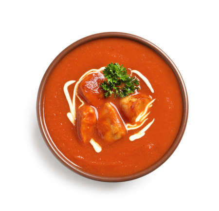 Bowl of delicious butter chicken on white background, top view. Traditional indian Murgh Makhani