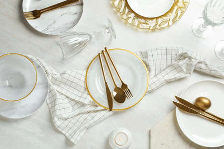 Festive Easter table setting on wooden background, top view