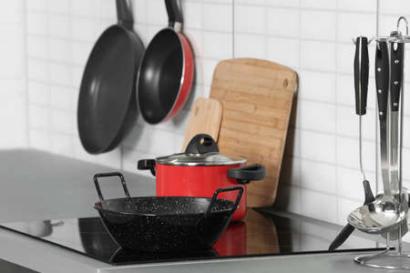 Set of clean cookware and utensils in kitchen
