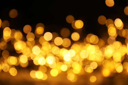 Gold glitter with bokeh effect on dark background 免版税图像