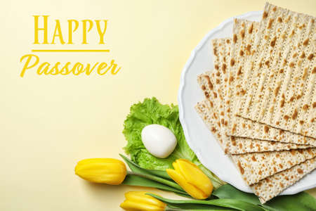 Flat lay composition with matzo on color background. Happy Passover (Pesach)