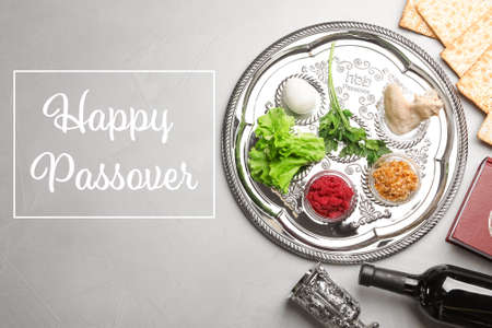Flat lay composition of symbolic Pesach items on color background. Happy Passover