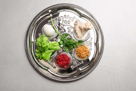 Traditional Jewish plate with symbolic meal for Passover (Pesach) Seder on table, top view