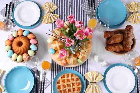 Festive Easter table setting with traditional meal, top view
