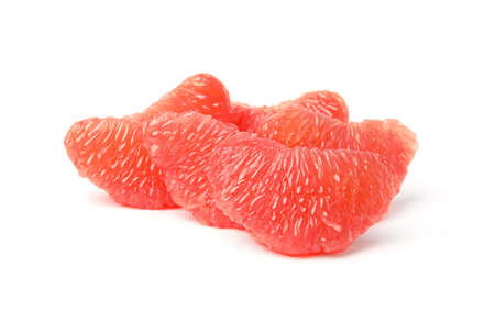 Slices of ripe juicy grapefruit on white background