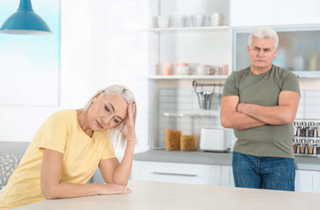 Mature couple arguing in kitchen. Relationship problems