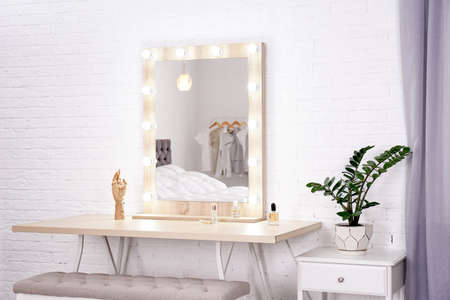 Dressing room interior with makeup mirror and table Stock Photo