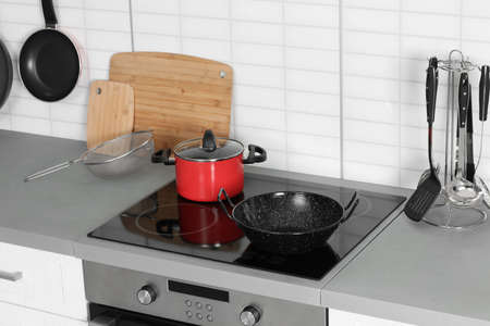Clean cookware and utensils in modern  kitchen