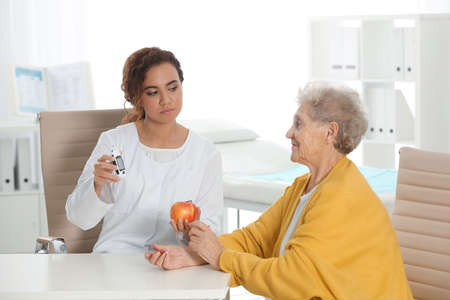 Senior woman visiting endocrinologist in clinic. Diabetes diet.