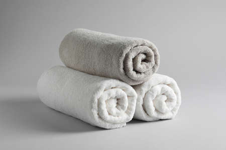 Fresh soft rolled towels on light background