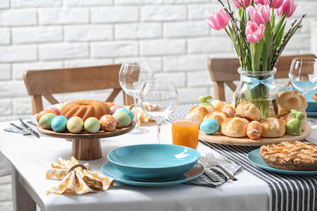 Festive Easter table setting with traditional meal at home Stock Photo