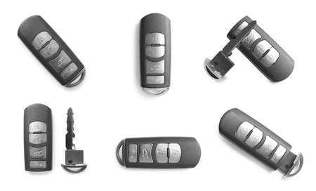 Set of modern car keys on white background, top view Imagens