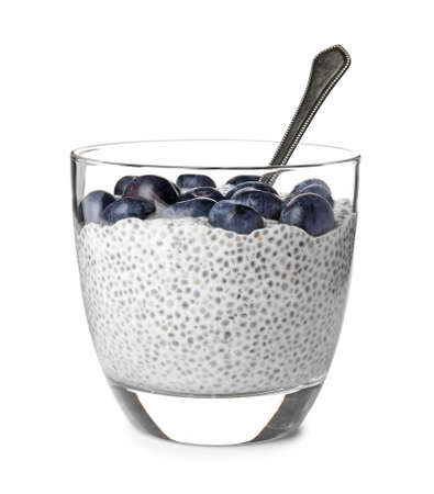 Tasty chia seed pudding with blueberries in glass on white background