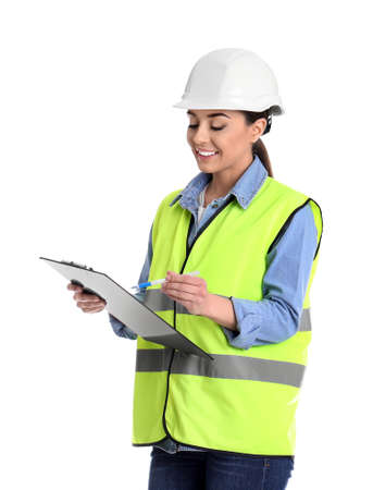 Female industrial engineer in uniform with clipboard on white background. Safety equipment 免版税图像