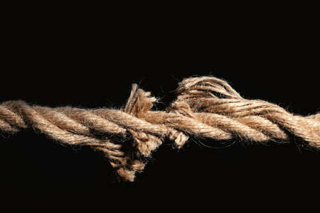 Rupture of cotton rope on black background 스톡 콘텐츠
