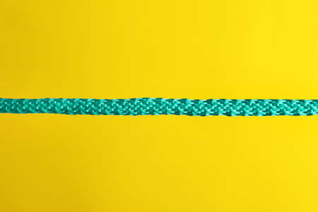 Strong straight blue rope on color background Stock Photo