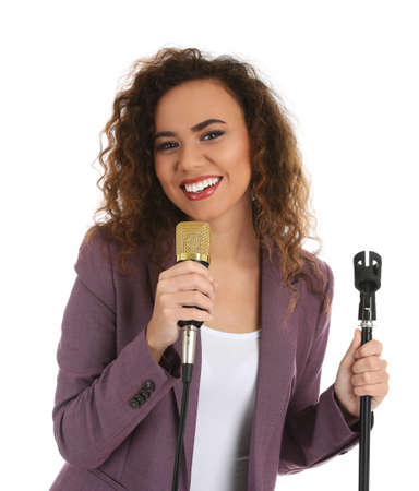 African-American woman in suit posing with microphone on white background