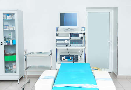 Interior of diagnostic room with modern equipment in clinic Stock Photo