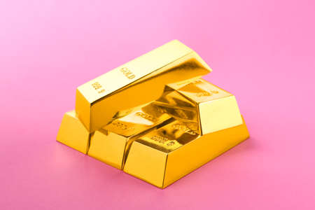 Precious shiny gold bars on color background Stock Photo